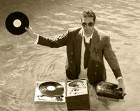 Dj in sea. A young dj plays music in the sea Royalty Free Stock Images