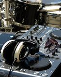 DJ set with drums. DJ set with mixer, headset and sunglasses with drumkit Royalty Free Stock Photography