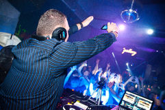 DJ shoots video on mobile phone Stock Photos