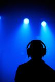 Dj silhouette. On foggy blue background Stock Photos