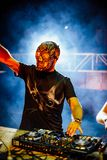 DJ with Skull mask playing electronic music at Summer Party Fest. Ival. Fun, youth, entertainment and fest concept royalty free stock photos