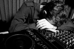DJ sleeping in a nightclub Stock Images