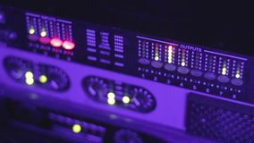 DJ sound equipment. Night club music. Defocused buttons of mixing console stock video
