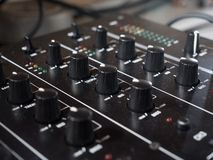 Dj sound mixing board, close-up royalty free stock photography