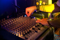Dj on sound table Royalty Free Stock Images