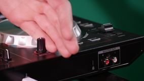 DJ is spinning the disk on the equipment stock video footage