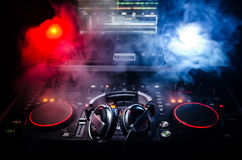 Free DJ Spinning, Mixing, And Scratching In A Night Club, Hands Of Dj Tweak Various Track Controls On Dj S Deck, Strobe Lights And Fog, Royalty Free Stock Photos - 91620728
