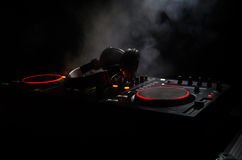Free DJ Spinning, Mixing, And Scratching In A Night Club, Hands Of Dj Tweak Various Track Controls On Dj S Deck, Strobe Lights And Fog Royalty Free Stock Photography - 95767797
