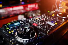 DJ spinning mixing and scratching track controls on dj`s deck st royalty free stock image
