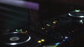 Dj spinning at turntable on party in nightclub. Holidays. Equipment. Mixing. Cheering stock footage