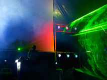 DJ on stage inside laser rays stock photos