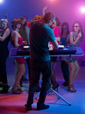 Dj standing and mixing music at party Stock Images