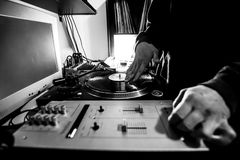 Dj in studio with turntable and mixer Stock Photos