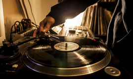 Dj in studio with turntable Royalty Free Stock Images