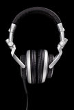 DJ Style Headphones. A pair of DJ style headphones isolated on black Stock Photos
