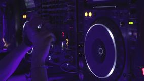 DJ switching controls on modern sound board, mixing music in night club, party. Stock footage stock video footage