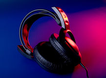 DJ tool on the party. Headphones in color light stock photo