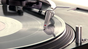 DJ Turntable. Close-up of a spinning vinyl record player. 