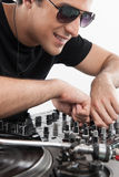 DJ at the turntable. Royalty Free Stock Image