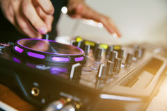 DJ turntable console mixer controlling Royalty Free Stock Image