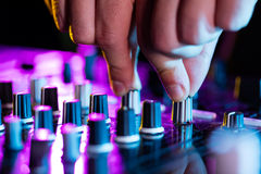 DJ turntable console mixer controlling with two Stock Image