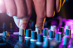 DJ turntable console mixer controlling with two Royalty Free Stock Photos
