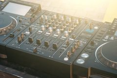 DJ turntable deck mixer close up, sound equipment, audio control panel for party, night clubs or music studio Royalty Free Stock Photos