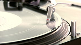 DJ Turntable. Dropping the needle on a spinning vinyl record player stock video footage