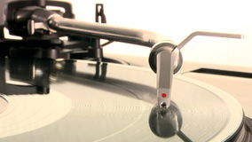 DJ Turntable. Dropping the needle on a spinning vinyl record player stock video