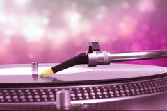 Dj turntable with pink bokeh background Royalty Free Stock Photography