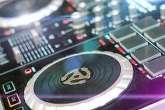 DJ turntable sound mixer in nightclub. DJ sound mixer in nightclub Royalty Free Stock Photography