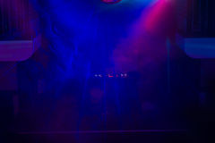 DJ and Turntable on Stage in Night Club stock photos