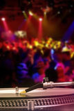 Dj turntable with vinyl record in the nightclub Stock Photos