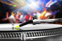 Dj Turntable With Vinyl Record In The Dance Club Stock Images