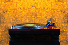 Dj turntable on yellow background out of focus Royalty Free Stock Photography