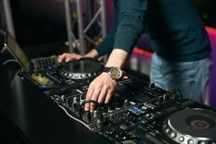 DJ with Turntables playing music at mixer. Dj mixing indoor at party festival Stock Photography