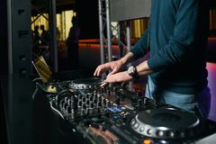 DJ with Turntables playing music at mixer. Dj mixing indoor at party festival Stock Image