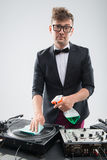 DJ in tuxedo cleaning his turntable Royalty Free Stock Images