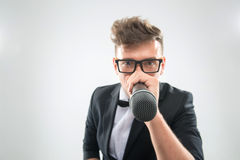 DJ in tuxedo holding microphone and headphones Royalty Free Stock Photo