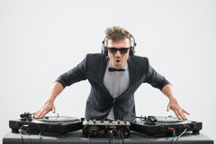 DJ in tuxedo mixing by turntable Stock Photos