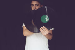 Dj with two vinyl and headphones royalty free stock photo