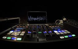 DJ Panel setup for rave party. The dj uses a mixing console  and portable pc to manage elettronic music Royalty Free Stock Image
