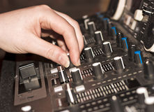 DJ Using Audio Mixing Deck in Club Royalty Free Stock Photography