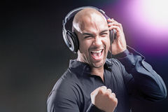 Dj wearing headphones Royalty Free Stock Photo
