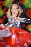 Dj woman with colorful vinyl record Stock Image