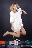 Dj woman with megaphone and spring Royalty Free Stock Photos