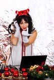 DJ woman New Year Santa costume headphones silver background par stock photo