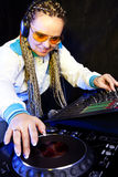 Dj woman playing music Stock Images