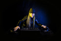 Dj woman playing music. Smiling dj woman playing music by mikser Royalty Free Stock Photo
