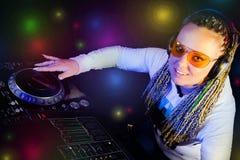 Dj woman playing music by mikser. Smiling dj woman playing music by mikser Royalty Free Stock Photo